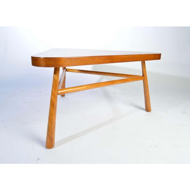 A 1950's Mahogany triangular cocktail table designed by T.H. Robsjohn-Gibbings for Widdicomb. Phenomenal overall...