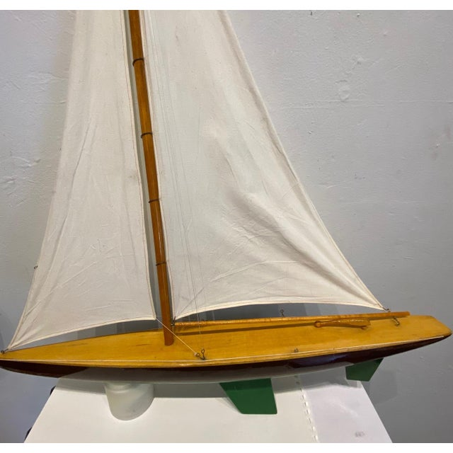 Vintage model sailboat that is a perfect decorative item for a beach house, nautical themed room or child's room. The...