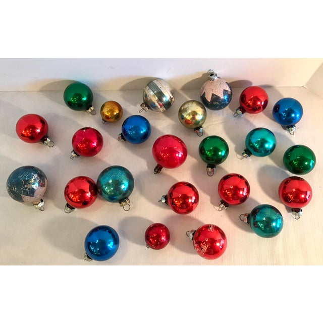 """Vintage glass ball ornaments in a variety of colors and sizes. Ornaments are 1.5"""" to 2""""."""