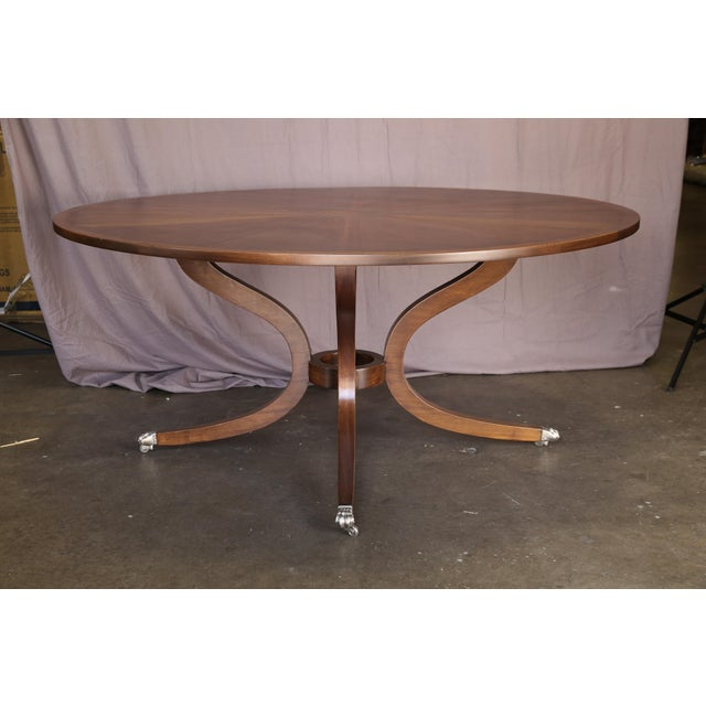 Beautiful refinished Dessin Fournir dining table with a walnut finish. Feet are in a mat pewter finish. Pristine...