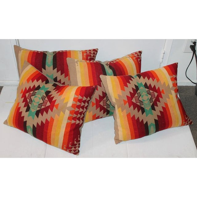 "Early Cayuse 1909 Pendleton camp blanket pillows. Each Pendleton pillow is 20"" x 16"". The backing is in tan cotton linen."