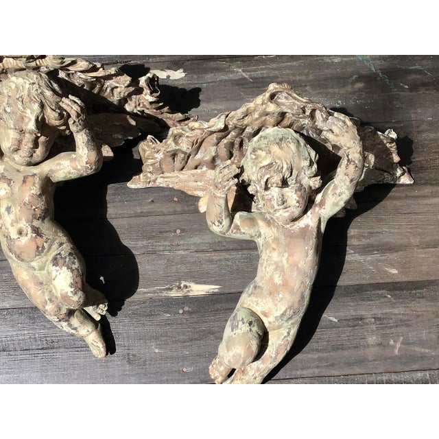 An impressive pair of European carved wall brackets. In the form of winged cherubs. Ready to mount onto a wall. Could...