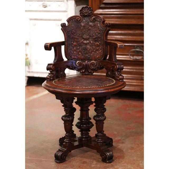 Decorate an office with this elegant antique armchair. Created in England, circa 1870, the chair stands on four feet...
