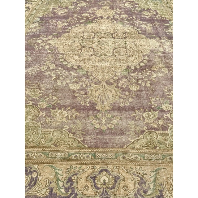 Antique Turkish Kerman rug features a center medallion surrounded by a faded plum.eggplant ground. Shades of light to dark...