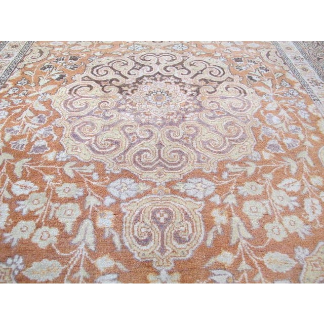 An elegant and subtle Tabriz scatter rug, in soft shades of rust, cream, gold, chocolate brown and lavender-grey.