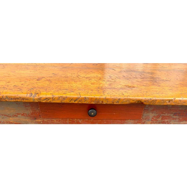 Stunning late 19th century southern red paint and chestnut farm table, of rectangular form the top constructed of two...