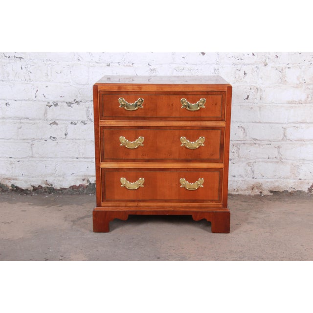 Chippendale style fruitwood bachelor chest or commode Made by Baker Furniture USA, Circa 1980s Book-matched fruitwood +...