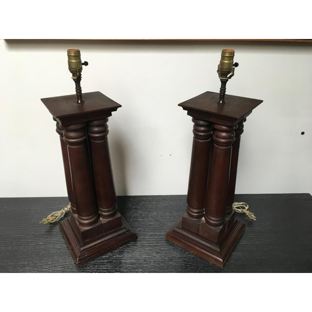 Fantastic pair of solid wood architectural lamps from the early 20th century. Comprised of four stylized columns (early...
