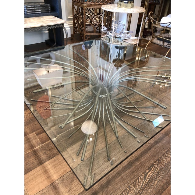 This is a beautiful iron cocktail table with a mellow gilt bronze like finish depicting a tree root. The square glass top...
