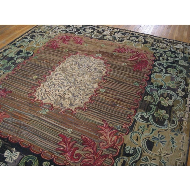 Antique American Hooked Rug with an ivory background.