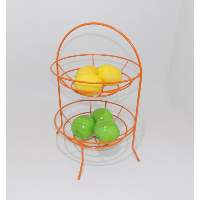 Cute and functional orange two tier wire basket. Perfect for a kitchen catchall. Use for fruit, veggies or floral display....