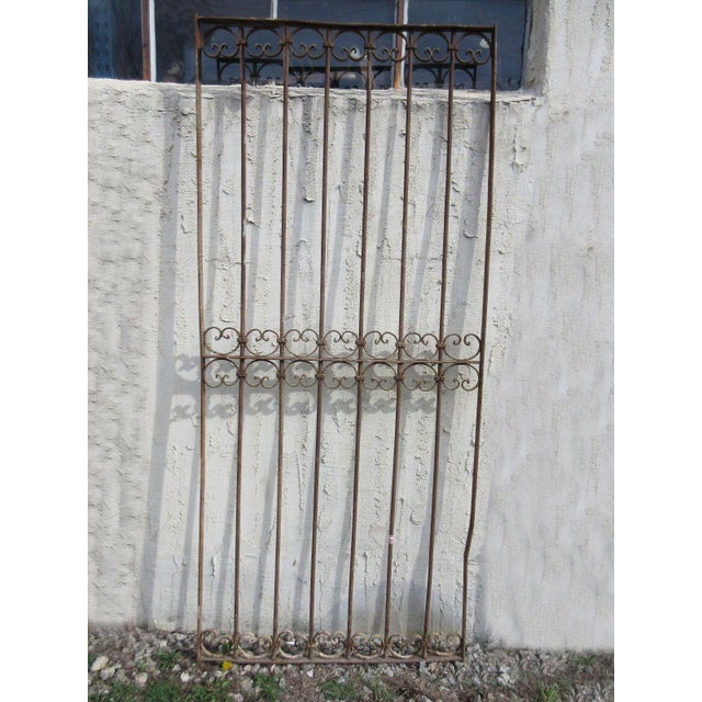 A piece of architectural salvage from an iron gate. Heavy and sturdy. Piece does show signs of age related wear including...