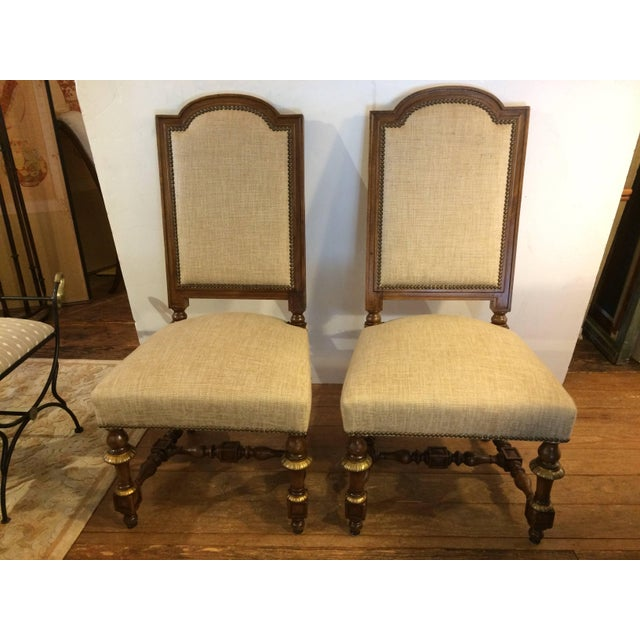 Set of 8 early French walnut/bronze ornamented chairs from St. Remy in Provence. Sturdy and comfortable with neutral Lee...