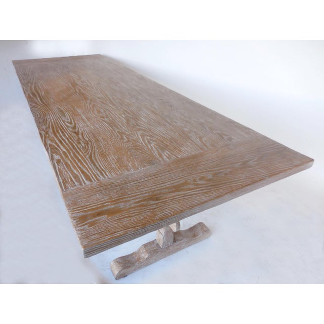 Custom classic trestle table in oak with an opened grain cerused finish, done in a snow on sand color. Wide breadboards,...
