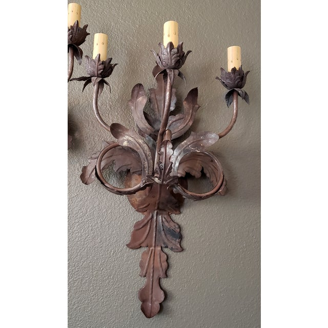 A Pair of Absolutely Stunning Vintage French Large Floral Sconces With Modern Wiring. Metal has a rusted bronze color...