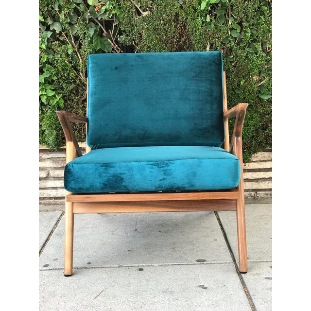Made of solid walnut with beautifully sculpted walnut arms. The seats are a velvet peacock color, luxurious feeling. Warm...
