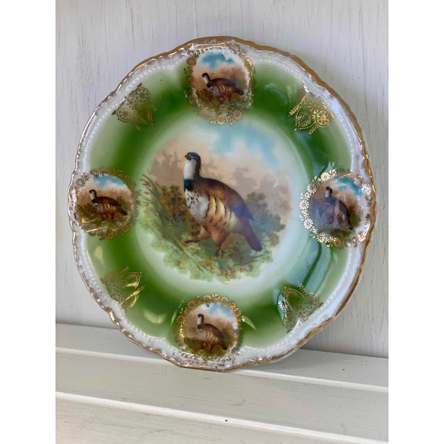 Bavaria German game, Pheasant plate with center bird surrounded by four additional birds surrounded in gilt floral wreaths.