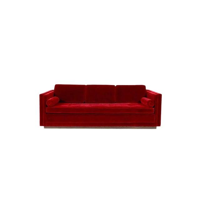 Tuxedo sofa by Ward Bennett. Deep red mohair over walnut plinth base.
