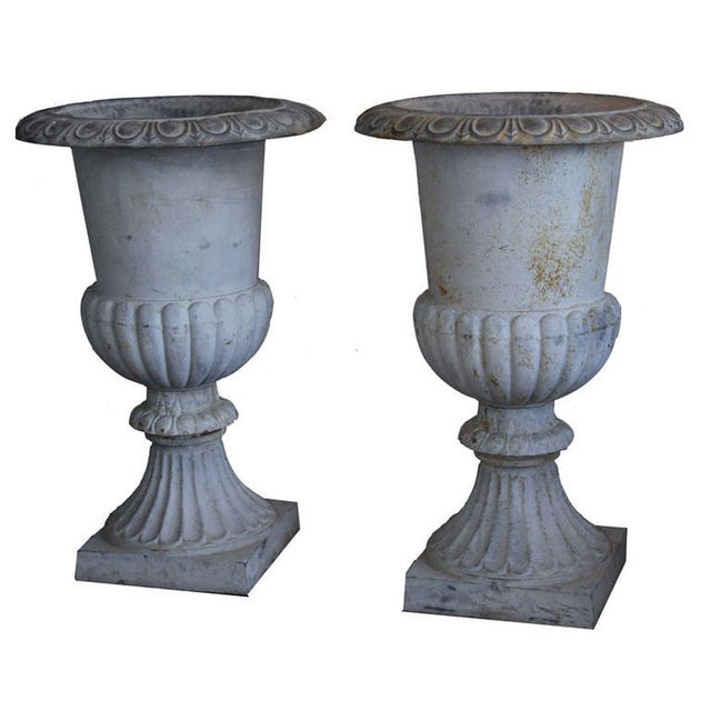 Set of two stately architectural cast iron urns from France. Rare and impressive because of size. These urns have great...
