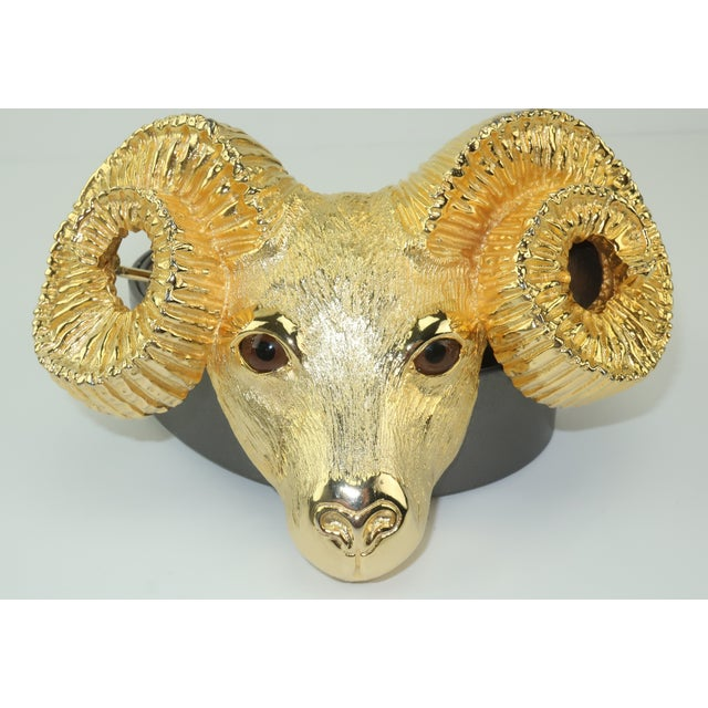 A statement making and head turning Margarita Barrera gilt gold tone metal Ram buckle with realistic amber glass eyes and...