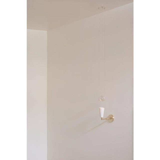 Contemporary Contemporary Grace White Porcelain Shade and Suspended Glass Sphere Brass Sconce For Sale - Image 3 of 9