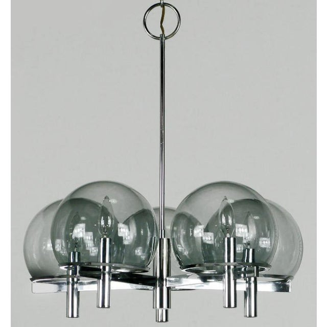 Italian modern five arm chrome and smoked glass globe chandelier by Gaetano Sciolari. Five chrome flat bar arms connect to...