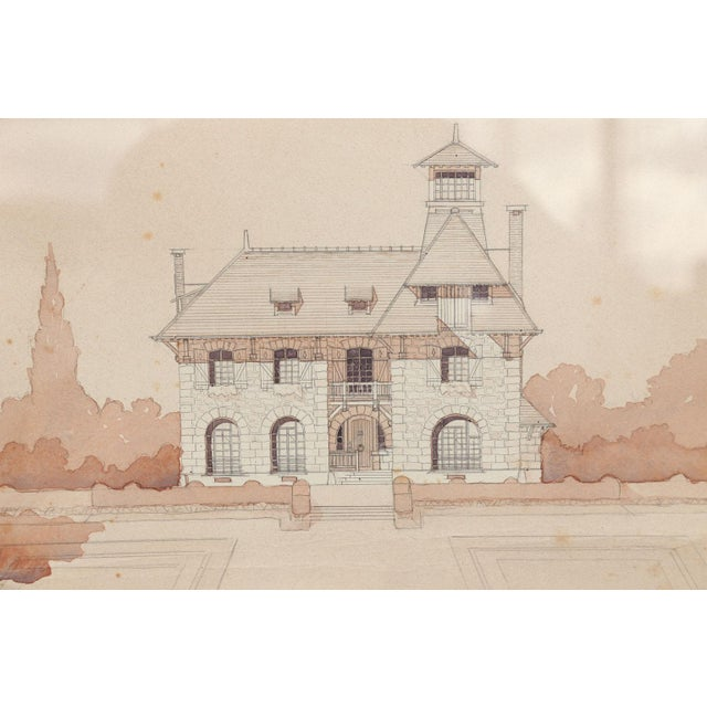 Watercolor architectural rendering in a blush color on paper within an ebonized frame. Signed by Charles Verdonnet and...