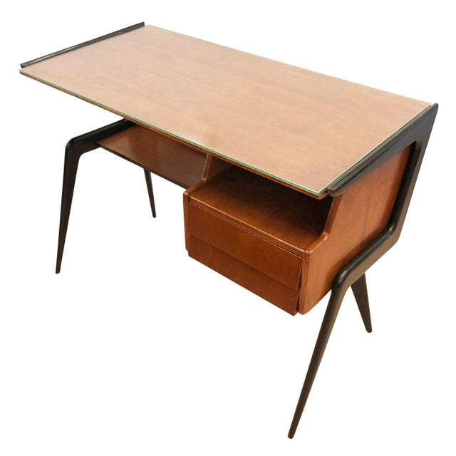 Beautiful Italian Mid-Century desk in the manner of Silvio Cavatorta. Walnut body with ebonized legs. Has a clear glass...