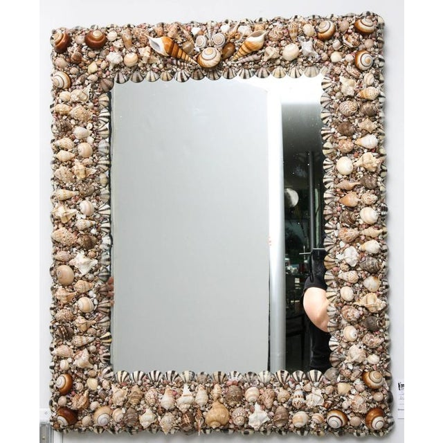 This bespoke, one-of-a-kind shell-encrusted mirror is very much in the style of pieces created by Tony Duquette in the...