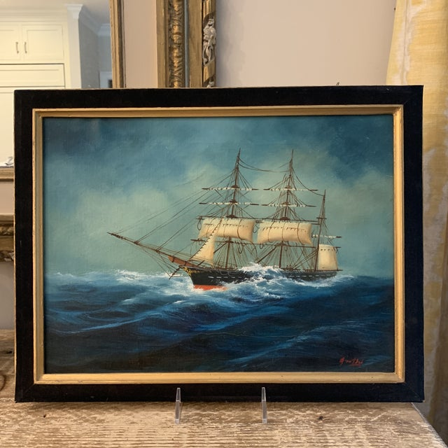 A vibrant and eye-catching original painting of a sailing ship on the seas. Unframed but includes a beautiful black velvet...