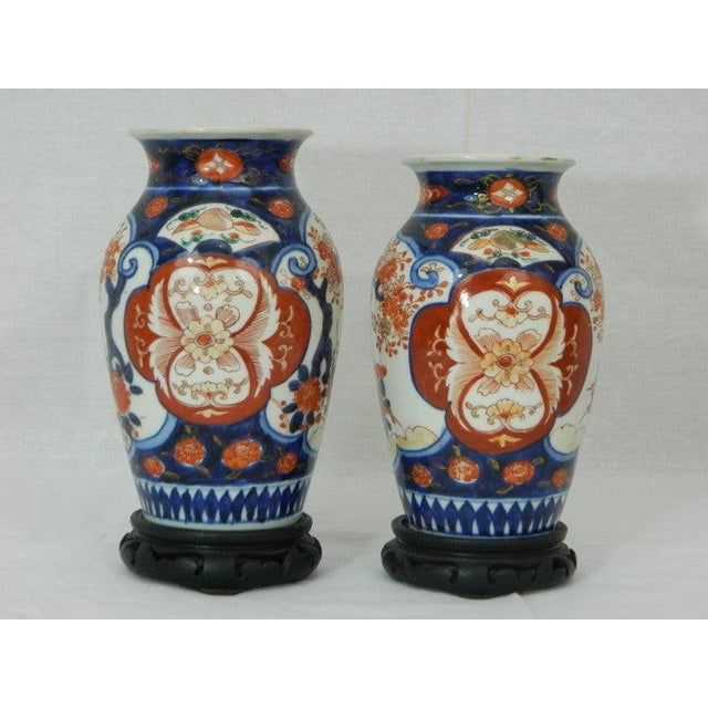 """Pair of beautiful Imari vases depicting floral decorations, 19th century. One vase is 9"""" high and the second is 8.75"""" high."""