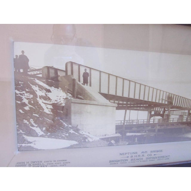 A large original vintage builders photo of the Brighton Beach RR Bridge at Neptune Ave. Hand lettered on the mat are the...