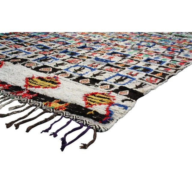 Azilal rug hand-loomed in the High Atlas Mountains of Morocco of wool with a low pile. Featuring an ornate diamond...