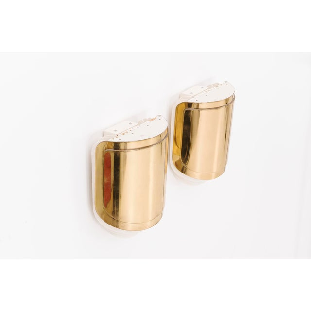 Warren Platner Associates commission for private residence. Custom wall sconce with lift-up brass shield with three steel...