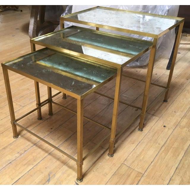 Marc du Plantier refined gold bronze 3 nesting tables.