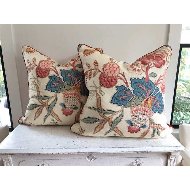 Beautiful pair of Euro size Jacobean floral pillows from a Clarence House textile. Each pillow is piped in a velvet trim...