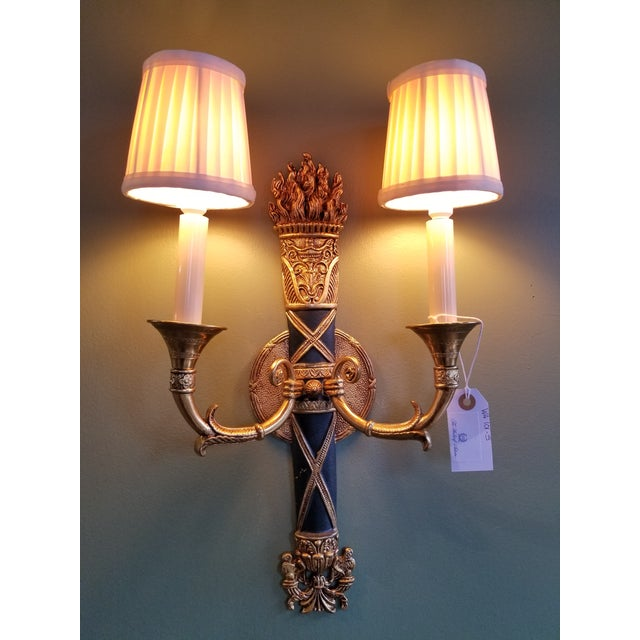Stunning pair of 1930s French cast brass and painted green torch 2 arm sconces from the famed Waldorf Astoria hotel in New...