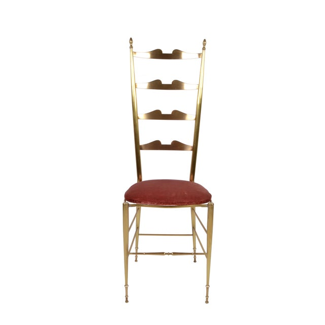 A pair of Italian bronze high back chairs by Chiavari. The bronze has a matte polish and the seat is upholstered in red...