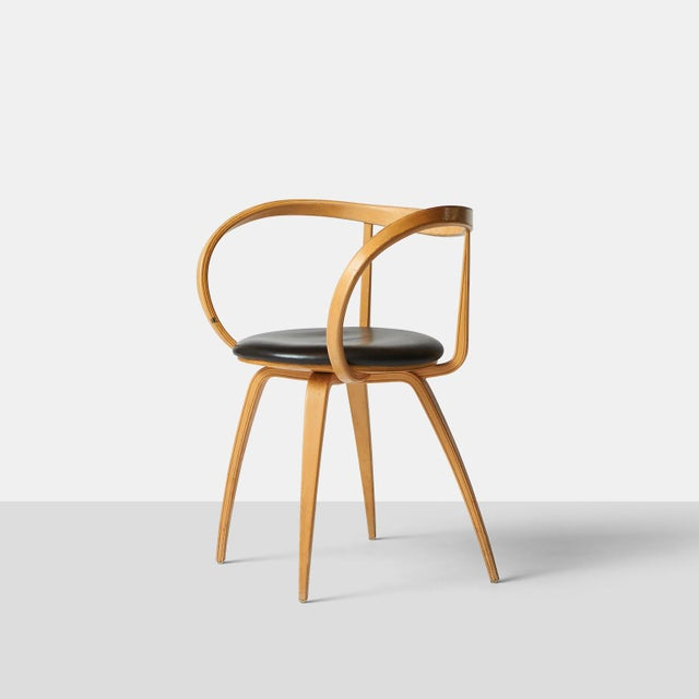 A rare pair of laminated birch and leather Pretzel chairs, no. 5890, by George Nelson. Originally designed for Herman...