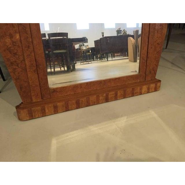 Very beautiful French Art Deco burl wood wall / standing mirror. Having stunning Art Deco lines and original mirror.