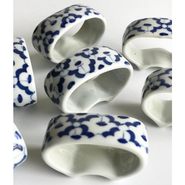 Set of 8 ceramic napkin rings. Hand painted blue design, on white base. Beautiful addition to your table and parties!