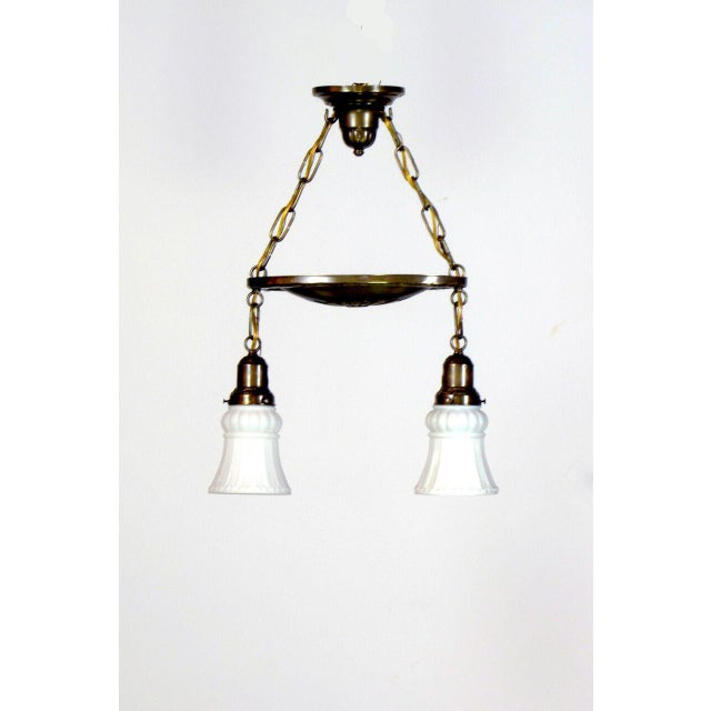 Brass two light pan fixture with canopy featuring original glass.