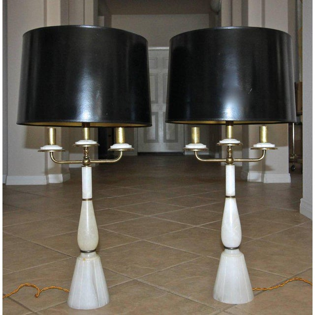 Pair of Gio Ponti style 1940s Italian alabaster candelabra lamps with brass arms and fittings. Newly restored and rewired...