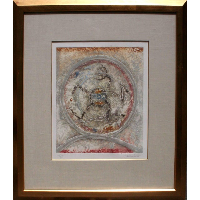 Geometric limited edition etching, hand painted, Abstract of a orange and blue figure inside of a circle by Pierre Brisson...