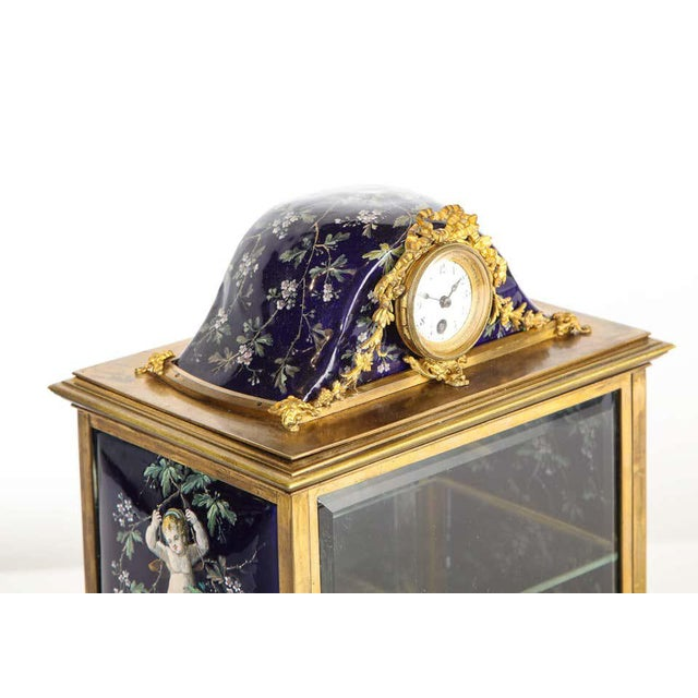 A french bronze and limoges enamel jewelry vitrine cabinet with clock, 19th century. Hand-Painted with beautiful cobalt...