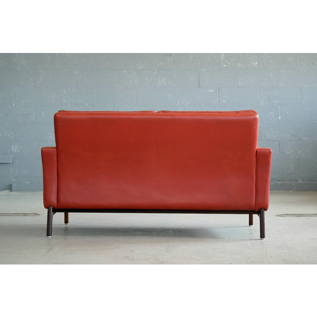 Classic Danish Mid-Century Modern Sofa in Red Leather and Rosewood Base For Sale - Image 10 of 11