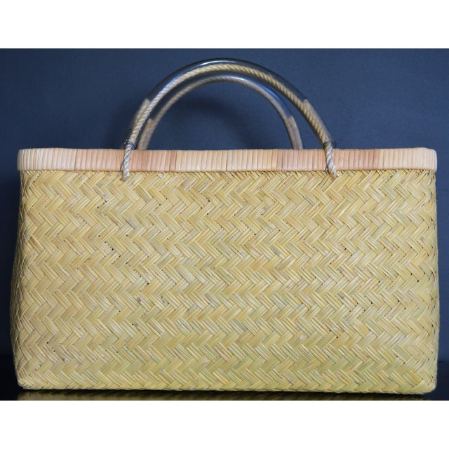 Usually seen around Tokyo's Tsukiji fish market, this large rectangular woven basket is found in the hands of the regular...