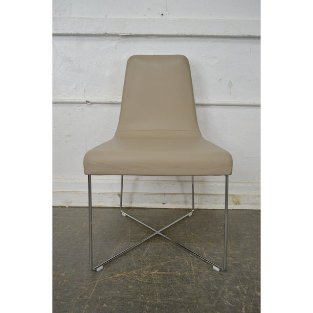 High quality set of 8 French Modern chrome frame & soft leather upholstered dining chairs. ~ By Ligne Roset.