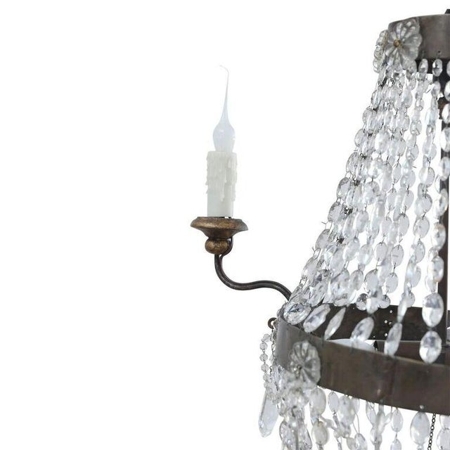 Petite Italian crystal chandelier from Le Marche. Neoclassical style chandelier is restored with later carved and gilded...