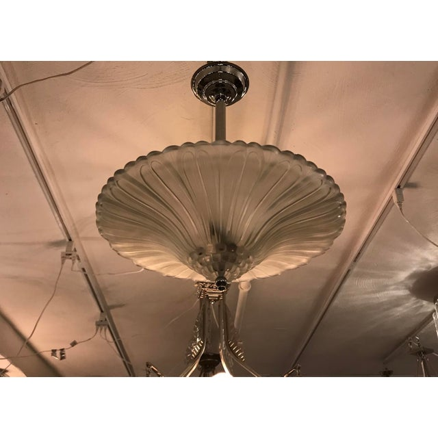 Incredible French Art Deco chandelier by Georges Leleu. With beautiful clear frosted glass bowl with geometric motif. Held...